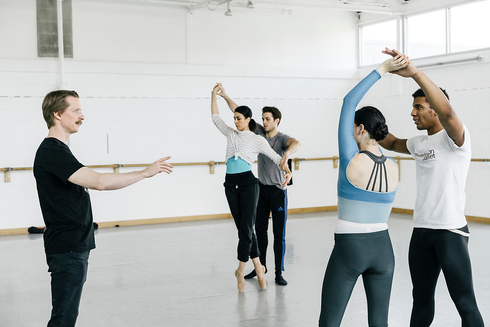 Choreographer Ethan Stiefel, left, works with dancers Sarah Steele and Gian Carlos Perez of the Washingon Ballet during rehearsals for Frontier on May 3, 2017. The piece is Julie Kent's' first commission as new director'. The ballet is about space exploration, and the costumes, designed by Ted Southern of Final Frontier Design, look similar to what astronauts wear.