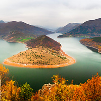 Spectacular lake meander rounded of colorful forest