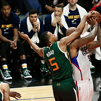 25 April 2017: LA Clippers center Marreese Speights (5) is fouled by Utah Jazz guard Rodney Hood (5) during the Utah Jazz 96-92 victory over the Los Angeles Clippers, during game 5 of the first round of the Western Conference playoffs, at the Staples Center, Los Angeles, California, USA.