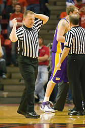 24 February 2009: Referee Terry Wymer communicates an offensive foul to the official scorer. The Redbirds of Illinois State University lost the Panthers of Northern Iowa in double overtime by a score of 69-67 on Doug Collins Court inside Redbird Arena on the campus of Illinois State University in Normal Illinois