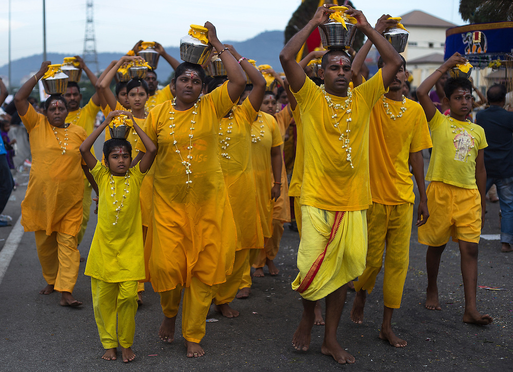 HIndu devotees walk with milk pots to the Batu Cave temple during a Thaipusam festival in Kuala Lumpur, Malaysia, 03 Fenruary 2015.  Thousands of Hindus gather to participate in the annual Thaipusam festival dedicated to Lord Murugan. During Thaipusam day, devotees will fulfilled their vows by carrying 'kavadi (bearers had spikes pierced into their bodies) or pots of milk as offering to Lord Murugan. The devotees will make the arduous climbing up the 272 steps leading up to the temple cave and deposited at the feet of the deity to purify themselves.
