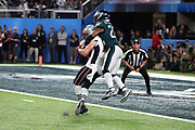 New England Patriots wide receiver Chris Hogan (15) catches a 26 yard touchdown pass that cuts the Philadelphia Eagles third quarter lead to 29-26 while covered on the play by leaping Philadelphia Eagles free safety Rodney McLeod (23) during the 2018 NFL Super Bowl LII football game against the Philadelphia Eagles on Sunday, Feb. 4, 2018 in Minneapolis. The Eagles won the game 41-33. (©Paul Anthony Spinelli)