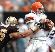 MORNING JOURNAL/DAVID RICHARD.Cleveland quarterback Charlie Frye is sacked by defensive tackle Brian Young of New Orleans yesterday.