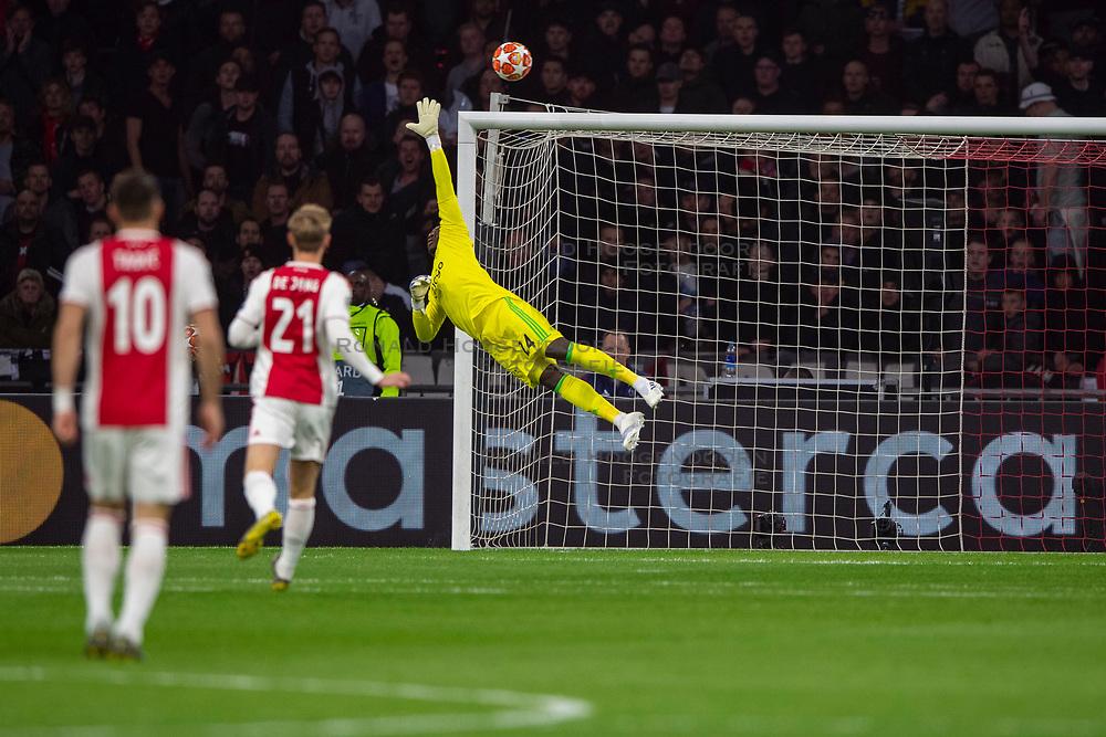 10-04-2019 NED: Champions League AFC Ajax - Juventus,  Amsterdam<br /> Round of 8, 1st leg / Ajax plays the first match 1-1 against Juventus during the UEFA Champions League first leg quarter-final football match / Andre Onana #24 of Ajax