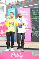 March 10, 2019 - London, United Kingdom - Dewi Griffiths and  Mo farrah are seen posing with their awards after running The Vitality Big Half, which has returned for a festival of running and culture to the heart of London in a celebration of the rich and wonderful diversity of the capital city and Finishing it at Cutty Sark. (Credit Image: © Terry Scott/SOPA Images via ZUMA Wire)