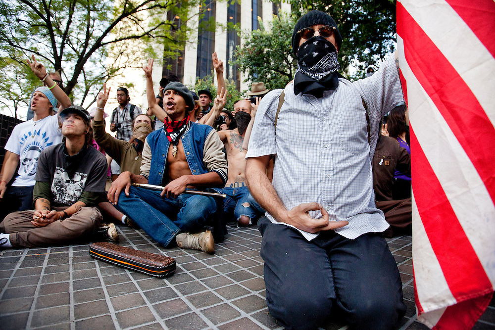 A group of Occupy LA demonstrators sit down and await arrest at Bank of America plaza in Los Angeles, Calif. on Thursday, November 17, 2011. (Photo by Gabriel Romero ©2011)