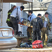 A Tupeloo fireman is transported to North Mississippi Medical Center after bieng injured at the scene of a house fire on Walker Street Monday morning.