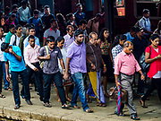 07 OCTOBER 2017 - COLOMBO, SRI LANKA: Passengers from an arriving commuter train walk along the platform at the Fort Station in Colombo. The Fort Station is Colombo's main train station and serves as the hub of Sri Lanka's train system. The station opened in 1917 and is modeled after Manchester Victoria Station.    PHOTO BY JACK KURTZ