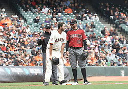 April 11, 2018 - San Francisco, CA, U.S. - SAN FRANCISCO, CA - APRIL 11: San Francisco Giants Starting Pitcher Andrew Suarez (59) pauses at third base and chats with Arizona Diamondbacks  3rd baseman Deven Marrero (10)during the game between the Arizona Diamondbacks and the San Francisco Giants on Wednesday, April 11, 2018 at AT&T Park in San Francisco, CA (Photo by Douglas Stringer/Icon Sportswire) (Credit Image: © Douglas Stringer/Icon SMI via ZUMA Press)