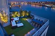 View of roof terrace, River Thames, astroturf, table and chairs, Rattan furniture, cushions