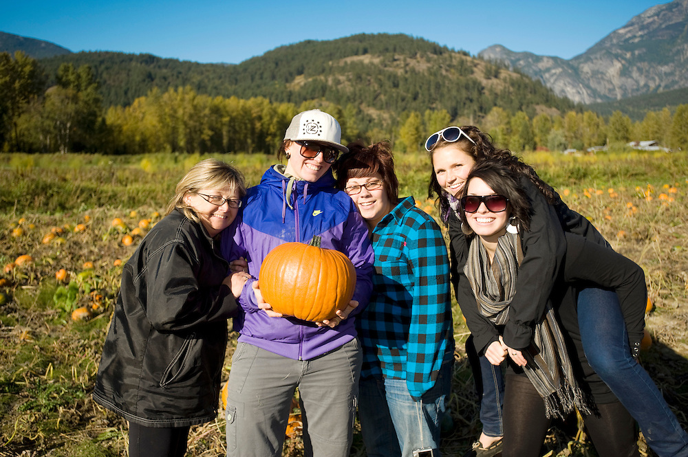 Fall pumpkins at the North Arm Farm.  (L-R) Linda Marshal, Jen Anderson, Nadia Henderson, Amanda Filipchuk, Emma Anderson.    Pemberton BC, Canada