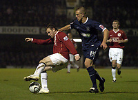 Photo: Olly Greenwood.<br />Southend United v Manchester United. Carling Cup. 07/11/2006. Manchester United's Wayne Rooney and SOuthend's Peter Clarke