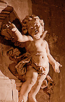 Detail of a winged stone carved cherub in a chapel at Avignon. France.