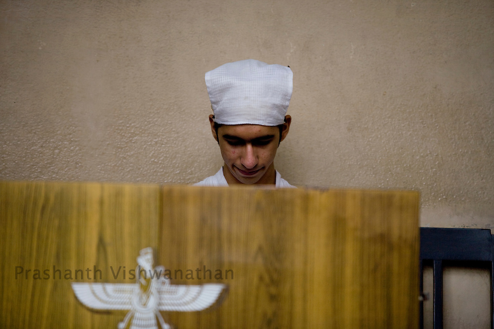 A Parsi youth reacts in his traditional Parsi attire  in the Kappawala Agiary, or Fire Temple, on Navroze, the Parsi new year, in Mumbai, India, Tuesday, Aug. 19, 2008. Parsis, also known as Zoroastrians, worship fire and are followers of the Bronze Age Persian prophet Zarathustra. According to estimates there are only 150,000 Zoroastrians in the world today and more than 80,000 live in India, mostly in Mumbai. Photographer:Prashanth Vishwanathan/Atlas Press