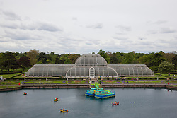 "© Licensed to London News Pictures. 23/05/2013. London, England. Pictured: High-angle view of the Palm House Pond with the ""Floating Pineapple Island"". Kew Gardens launches summer festival ""IncrEdibles"" with a ""Tutti Frutti Boating Experience"" on Palm House Pond designed by Bompas & Parr, a ""Bouncy Carrot Patch"" and an ""Alice in Wonderland""-inspired Tea Party in the Rose Garden. The Festival runs from 25 May to 3 November 2013, boating finishes 1 September. Photo credit: Bettina Strenske/LNP"
