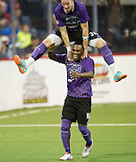 Jamie Lovegrove (32) of the Dallas Sidekicks jumps over teammate Patrick Shamu (18) after Shamu scored a goal against the Rockford Rampage at the Allen Event Center on Saturday, February 9, 2013 in Little Elm, Texas. (Cooper Neill/The Dallas Morning News)