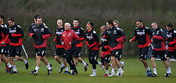 CHESTER, ENGLAND - Monday, February 4, 2008: Wales' assistant coach Roy Evans leads his players during training at the Carden Park Hotel ahead of their friendly match against Norway. L-R: Carl Fletcher, David Cotterill, Roy Evans, Neal Eardley, Carl Robinson, Robert Earnshaw and Simon Davies. (Photo by David Rawcliffe/Propaganda)