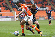 Bradford City midfielder Callum Guy (18) and Blackpool midfielder Colin Daniel (23) during the EFL Sky Bet League 1 match between Blackpool and Bradford City at Bloomfield Road, Blackpool, England on 7 April 2018. Picture by Craig Galloway.