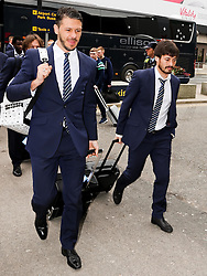 Manchester City's Martin Demichelis & David Silva arrive at Manchester Airport to board the team flight to Barcelona ahead of the UEFA Champions League second leg match against Barcelona - Photo mandatory by-line: Matt McNulty/JMP - Mobile: 07966 386802 - 17/03/2015 - SPORT - Football - Manchester - Manchester Airport - Barcelona v Manchester City - UEFA Champions League