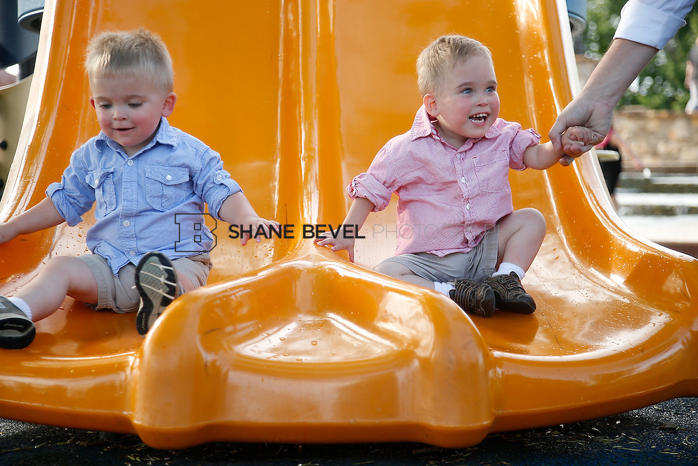 5/28/15 6:04:35 PM -- Miracle Miles and his family pose for portraits and play at the QuikTrip park for the 2015 Saint Francis Health System advertising campaign. <br /> <br /> Photo by Shane Bevel