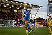Peterborough United forward Matt Godden (9) climbs highest during the EFL Sky Bet League 1 match between Peterborough United and Oxford United at London Road, Peterborough, England on 8 December 2018.
