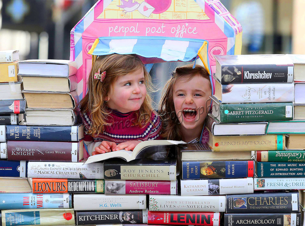 "REPRO FREE. 10/02/2013. Free To Use Image. Waterford Writers Weekend. Pictured at Waterford City at a photocall for the Third Annual Waterford Writers Weekend. Pictured are Rosie and Katie Flynn getting in some light reading. The country's top authors will descend on Waterford City for four days next month from March 21 to 24 to impart their knowledge and stories to keen literary audiences. The programme for the fourth annual Waterford Writers Weekend festival was launched in the city centre today, Sunday February 10, 2013. Picture: Patrick Browne<br /> <br /> Ireland's Top Authors to Descend on Third Annual Waterford Writers' Weekend<br />  <br /> The country's top authors will descend on Waterford City for four days next month from March 21 to 24 to impart their knowledge and stories to keen literary audiences. The programme for the fourth annual Waterford Writers Weekend festival was launched in the city centre today, Sunday February 10, 2013.<br />  <br /> Award winning authors such as Jimmy Magee, Kate Kerrigan, Hazel Gaynor, Anna Carey, Ferdia MacAnna and Dave Duggan will appear, to name but a few. In all, thirty-two authors, journalists and bloggers will host readings, writing workshops, debates and discussions for avid readers, novice writers, children and anyone with an interest in the magic of books.<br />  <br /> Launching the programme for the 2013 festival Director of the Waterford Writers' Weekend Katherine Collins said, ""We are delighted to be launching this amazing line-up of renowned authors and speakers for this our third festival; this festival has grown enormously over the last few years and only because we have such an interest from the public, we have full houses every year and we are looking forward to welcoming visitors old and new again this year.""<br />  <br /> Opening the festival on Thursday March 21 are the Seán Dunne Young Writers' Awards. The Awards are a tribute to the work of the late poet, and continue to promote the work of aspiring young authors. On Friday, a discussion on"