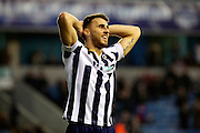 Millwall striker Lee Gregory (9) holding his head during the EFL Sky Bet League 1 match between Millwall and Shrewsbury Town at The Den, London, England on 10 December 2016. Photo by Matthew Redman.