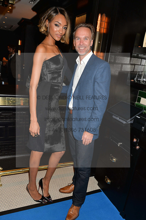 JOURDAN DUNN and MARCUS WAREING at the Maybelline New York: Party, part of the London Fashion Week Spring Summer 15 held at Tredwell's, 4a Upper St Martins Lane, London on 12th September 2014.