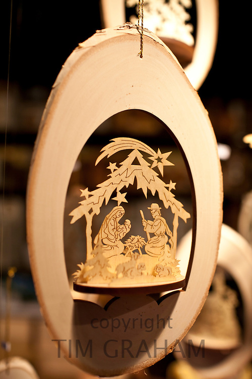 Wooden carved nativity scene crib at Christmas market, Winter Wonderland, in Hyde Park, London