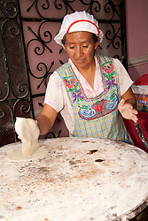 North America, Mexico, Oaxaca Province, Oaxaca, woman cooking tortillas in restaurant
