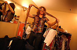 The post-punk band The Killers perform at the Hammerstein Ballroom at Manhattan Center Studios in New York, N.Y. on Oct. 24, 2008. Guitarist Dave Keuning gets dressed backstage before the show.