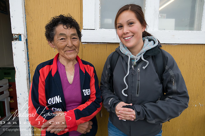 Rosa of Rosa's Butik and her grand daughter at Rosa's  small store, in the seaside village of Qeqertarsuaq, Greenland