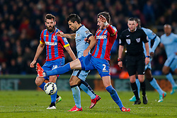 Sergio Aguero of Manchester City is challenged by Joe Ledley and Joel Ward of Crystal Palace - Photo mandatory by-line: Rogan Thomson/JMP - 07966 386802 - 06/04/2015 - SPORT - FOOTBALL - London, England - Selhurst Park - Crystal Palace v Manchester City - Barclays Premier League.