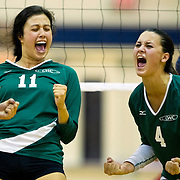 Daisy Gonzalez #11 and Andrea Gonzalez #4 of The Golden West Rustlers react after winning a point during a match against the Orange Coast Pirates on November 7, 2014 in Costa Mesa, CA. (Photo by Ben Jackson)