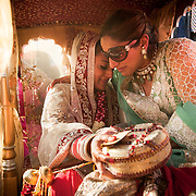 A bride cries during the Vidai ceremony of her Hindu wedding in Jaipur. The Vidai marks the formal departure of the bride from her parents home to start a new life at her husband's home. It is often a very emotional moment. end of the wedding ceremony