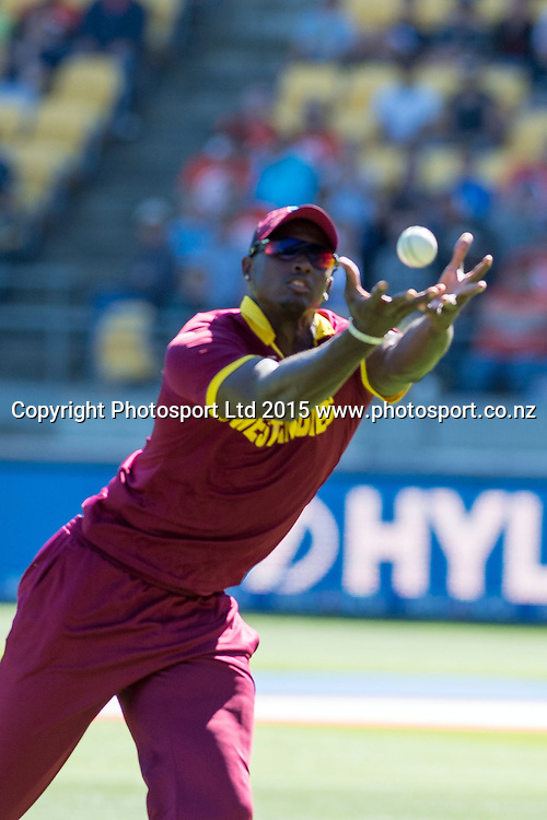West Indies captain Jason Holder takes the catch of Brendon McCullum during the ICC Cricket World Cup Quaterfinal match between New Zealand and West Indies at Westpac Stadium in Wellington, New Zealand. Saturday 21  March 2015. Copyright Photo: Raghavan Venugopal / www.photosport.co.nz