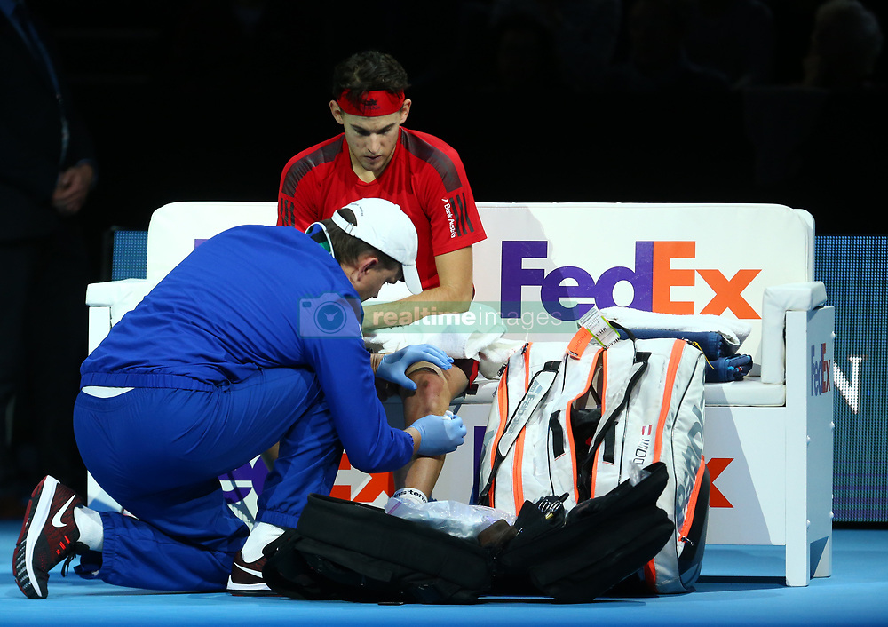 November 17, 2017 - London, United Kingdom - Dominic Thiem of Austria picks up a injury against David Goffin of Belgium.during Day six of the Nitto ATP World Tour  Finals played at The O2 Arena, London on November 17 2017  (Credit Image: © Kieran Galvin/NurPhoto via ZUMA Press)