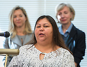 Mayralina Gonzalez, a parent volunteer a news conference discussing back to school parenting at Cunningham Elementary School, September 3, 2015.