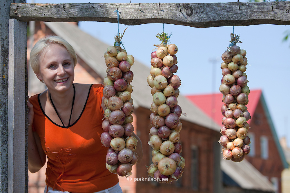 Young Woman and Onion Bundle, Kasepää Village, Tartu County, Estonia