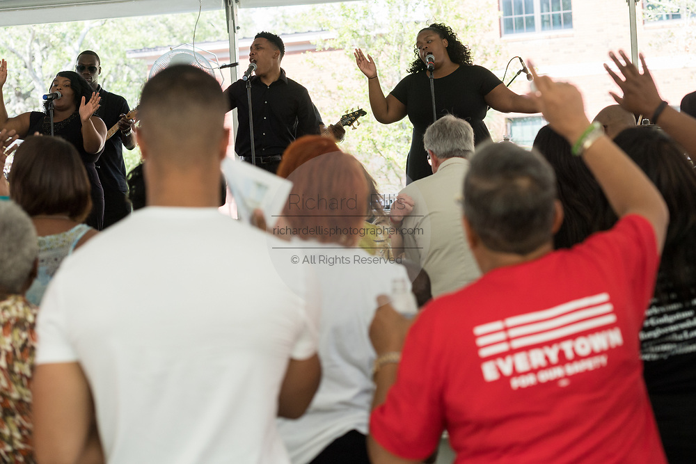 Jarell Smalls & Company lead the audience in praise songs during a memorial service for the victims of the Mother Emanuel African Methodist Episcopal Church shooting on the 2nd anniversary June 17, 2017 in Charleston, South Carolina. Nine members of the historic African-American church were gunned down by a white supremacist during bible study on June 17, 2015.