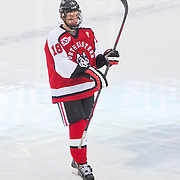John Stevens #18 of the Northeastern Huskies in action during the Frozen Fenway game between The Northeastern Huskies and The UMass Lowell Riverhawks at Fenway Park on January 11, 2014 in Boston, Massachusetts.