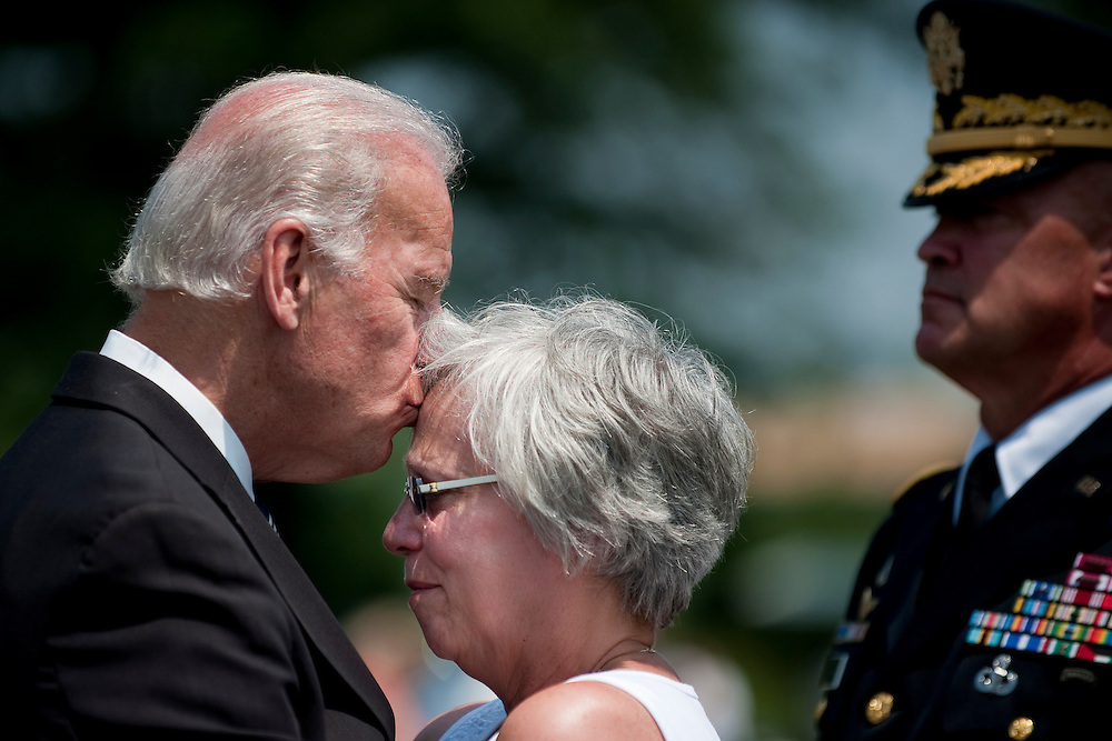May 31, 2010 - Washington, District of Columbia, U.S., -  Vice President Joe Biden kisses the forehead of Susan Van Aalten during a visit to Section 60 of Arlington National Cemetery on Memorial Day. Aalten 's son, Sergeant Alexander Van Aalten, 21, of Monterey, Tennessee, was killed April 20, 2007, in Sangin, Afghanistan, of wounds suffered when a land mine detonated near his unit during combat operations. He was assigned to the 1st Battalion, 508th Parachute Infantry Regiment, 4th Brigade Combat Team, 82nd Airborne Division, Fort Bragg, North Carolina. (Credit Image: © Pete Marovich/ZUMA Press)