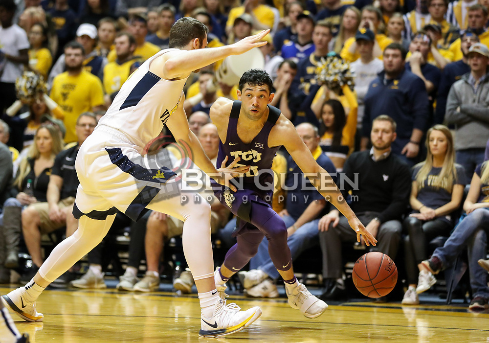 Feb 12, 2018; Morgantown, WV, USA; TCU Horned Frogs guard Alex Robinson (25) drives baseline during the first half against the West Virginia Mountaineers at WVU Coliseum. Mandatory Credit: Ben Queen-USA TODAY Sports