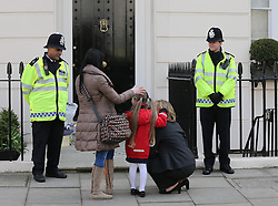 A young  girl and her family look at the flowers outside Baroness Thatcher's house in London, Wednesday, 10th April 2013 Photo by: Stephen Lock / i-Images