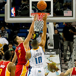 Jan 9, 2013; New Orleans, LA, USA; New Orleans Hornets shooting guard Eric Gordon (10) shoots over Houston Rockets point guard Jeremy Lin (7) during the second half of a game at the New Orleans Arena. The Hornets defeated the Rockets 88-79. Mandatory Credit: Derick E. Hingle-USA TODAY Sports