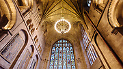 HEREFORD, UK January 23rd 2019 - Stained glass windows and stone ceiling at Hereford Cathedral, Herefordshire, United Kingdom