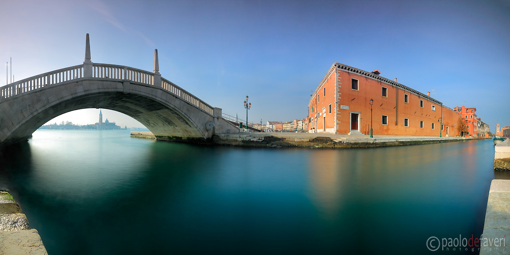 A panoramic view at noon of the Arsenale Canal (Rio dell'Arsenale), with the Forni Militari palace and the Arsenale gate in the background. This is stitched from nine vertical frames, each of them exposed for 30""