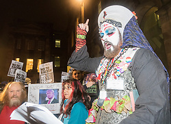 Hundreds of protesters march through Edinburgh to campaign against incoming US president Donald Trump, coinciding with his inauguration in Washington.<br /> <br /> A Rite of Canonical Indictment &amp; Excommunication of Donald J.Trump is performed by the Order of Perpetual Indulgence and will is conducted by Sister Ann Tici Pation OPI. Similar ceremonies are being performed throughout the world by OPI members.<br /> <br /> The text and structure of this excommunication rite is adapted from one introduced by the Pope Zachary in the 8th Century, as described in the Pontificale Romanum and practiced up until the Second Vatican Council in 1962. The ceremony traditionally involved a bishop, with twelve priests with candles, and is solemnly pronounced in some suitably conspicuous place. The bishop would then pronounce the formula of the anathema. After the pronouncement, the bishop would then ring a bell, close a holy book, and the assisting priests would snuff out their candles by dashing them to the ground, and thus was born the expression &quot;by bell, book and candle&quot;.<br /> The Sisters and Brothers of the Order of Perpetual Indulgence are part of a worldwide order of queer people of all sexualities. Formed around 1979 in response to attacks on the queer community by fundamentalist religious organisations, its tenets are: <br /> The expiation of stigmatic guilt, and <br /> The promulgation of universal joy.