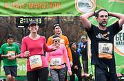 Sara Simonds, of Atlanta, (5261) finishes the Publix Georgia Half Marathon Sunday, March 22, 2015, in Atlanta. David Tulis / AJC Special