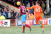 Scunthorpe United defender Rory McArdle (23) and Shrewsbury Town forward Stefan Payne (45) battles for possession  during the EFL Sky Bet League 1 match between Scunthorpe United and Shrewsbury Town at Glanford Park, Scunthorpe, England on 17 March 2018. Picture by Mick Atkins.